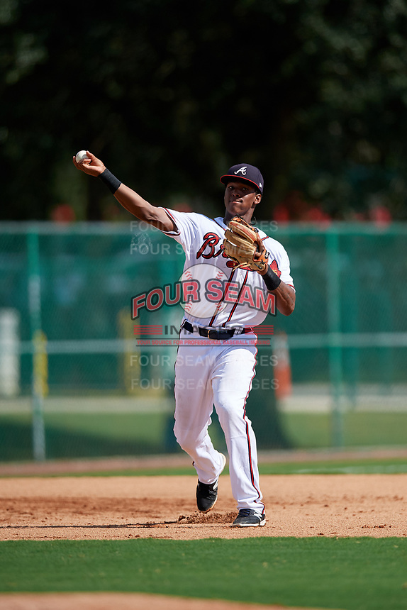 GCL Braves third baseman Darling Florentino (22) throws to first base during the first game of a doubleheader against the GCL Yankees West on July 30, 2018 at Champion Stadium in Kissimmee, Florida.  GCL Yankees West defeated GCL Braves 7-5.  (Mike Janes/Four Seam Images)