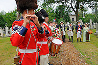 Members of the Second Company Governor's Foot Guard, Field Music Unit, New Haven, play fife and drum, soldiers, and wife, of the 6th Connecticut Regiment stand easy, and wreath is ready to be laid at grave of Roger Sherman during a July Fourth ceremony to recognize fallen patriots of the Revolutionary War, Grove Street Cemetery, New Haven, Connecticut, USA..