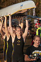 A mens rowing crew carries their boat to the water during early morning competition at the Fall Classic on Hoover Reservoir. The annual rowing competition is sponsored by the Westerville Rowing Club.