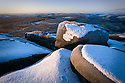 Snow covered gritstone boulders at sunrise, Higger Tor, Peak District National Park, Derbyshire, UK.