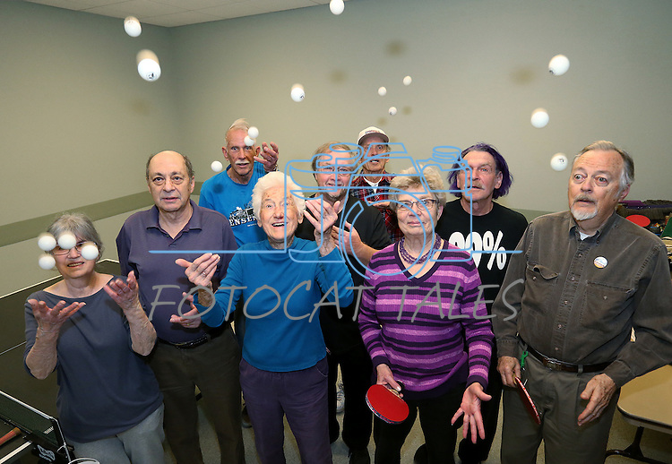 A group of competitors heading to the Reno-Tahoe Senior Winter Games table tennis competition pose for photos at the Carson City Senior Citizen Center in Carson City, Nev., on Friday, Jan. 29, 2016. <br /> Photo by Cathleen Allison/Nevada Photo Source