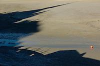 France, Manche (50), Baie du Mont-Saint-Michel, classée Patrimoine Mondial de l'UNESCO, l'ombre portée du Mont-Saint-Michel sur les grèves // France, Manche, Bay of Mont Saint Michel, listed as World Heritage by UNESCO, shadow of the abbey of the Mont Saint Michel on the bay