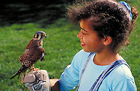 AFRICAN-AMERICAN GIRL WITH HAWK AT THE LINDSAY MUSEUM. CAUCASIAN GIRL WITH HAWK. WALNUT CREEK CALIFORNIA USA.