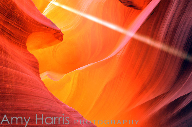 Abstract version of light shaft and sandstone formations in Lower Antelope Canyon outside of Page, Arizona.