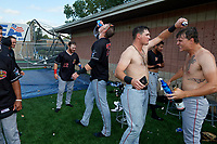 Batavia Muckdogs J.D. Orr (22), Sean Reynolds (25), Nic Ready and Evan Brabrand (right) celebrate after clinching the Pinckney Division Title during a NY-Penn League game against the Auburn Doubledays on September 2, 2019 at Falcon Park in Auburn, New York.  Batavia defeated Auburn 7-0 to clinch the Pinckney Division Title.  (Mike Janes/Four Seam Images)
