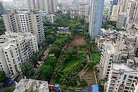 INDIA, Mumbai, green playground between skyscraper in suburb Goregoan