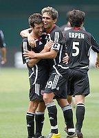 DC United midfielder Ben Olsen (14) celebrates with Jaime Moreno (99) his third goal of the game in the 84th minute 84th. Ben Olsen scored the first hat trick of his career against the Red Bulls. DC United defeated the New York Red Bulls 4-2, at RFK Stadium in Washington DC, Sunday June 10, 2007.