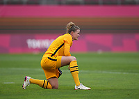 KASHIMA, JAPAN - AUGUST 2: Alyssa Naeher #1 of the United States takes a knee before subbing out due to an injury during a game between Canada and USWNT at Kashima Soccer Stadium on August 2, 2021 in Kashima, Japan.