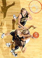 Nov. 14, 2010; Charlottesville, VA, USA; Virginia forward Jayna Hartig (32) fights for the rebound with Mount St. Mary's guard Ashley Christie (14), Mount St. Mary's forward Jessie Kaufman (32) and Mount St. Mary's forward Mary Dunn (24) during the game at the John Paul Jones Arena. Virginia won 81-58. Mandatory Credit: Andrew Shurtleff