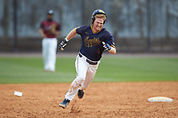 Dustin Baber (9) of the North Carolina A&T Aggies rounds second base against the North Carolina Central Eagles at Durham Athletic Park on April 10, 2021 in Durham, North Carolina. (Brian Westerholt/Four Seam Images)