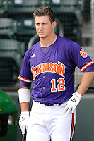 Infielder Jon McGibbon (12) of the Clemson Tigers prior to a fall Orange & Purple intrasquad scrimmage on November 2, 2013, at Fluor Field at the West End in Greenville, South Carolina. Orange won 7-1.(Tom Priddy/Four Seam Images)