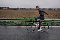 Jens Keukeleire (BEL/Lotto-Soudal) trying to keep warm by slapping his arms around<br /> <br /> 12th Strade Bianche 2018<br /> Siena > Siena: 184km (ITALY)