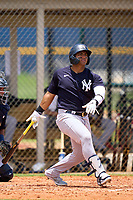 FCL Yankees Jasson Dominguez (25) hits a long fly ball down the line during a game against the FCL Tigers on June 28, 2021 at Tigertown in Lakeland, Florida.  (Mike Janes/Four Seam Images)