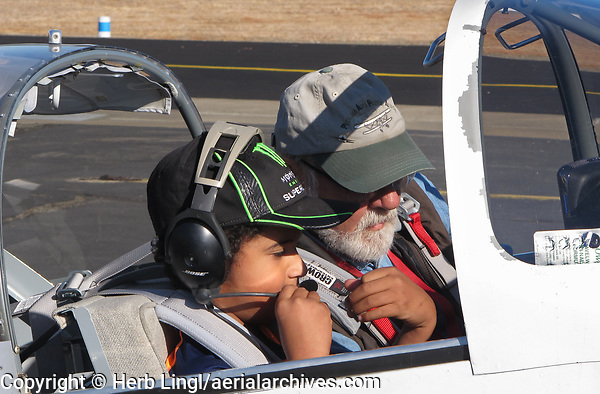 Pilot Rolf Unternaehrer prepares to take a boy for a flight in his Van's RV-6 during the Experimental Aircraft Association Young Eagles rally at Lampson Field (102), Lakeport, Lake County, California