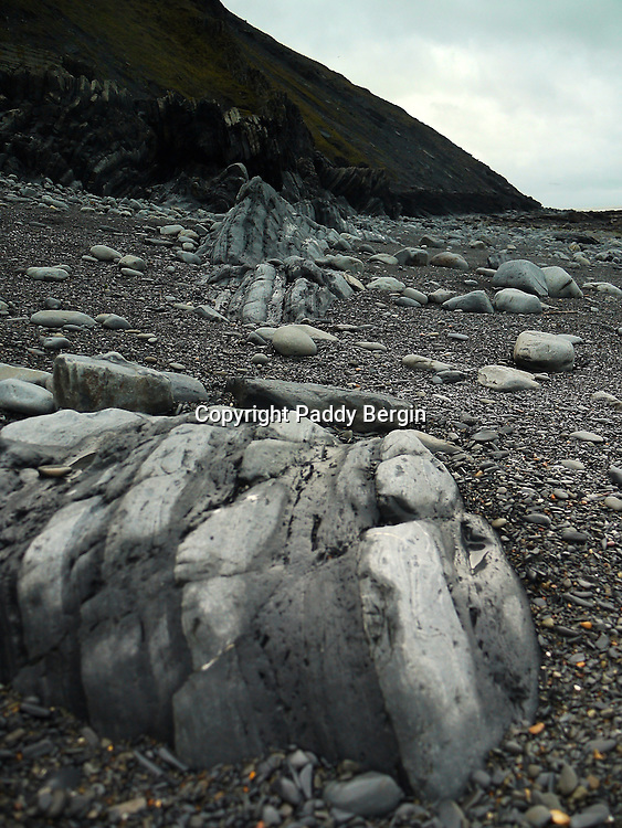 The rocks in Ceredigion were laid down on the floor of a deep-sea basin during the Silurian and Ordovician period some 505 to 406 million years ago. These sedimentary rocks – mudstones, siltstones and sandstones – were uplifted and emerged above the sea during a later mountain building period. This caused them to be folded and faulted. The eroded coastline provides a unique opportunity to see these rocks and their structures.<br /> <br /> Stock Photo by Paddy Bergin