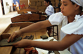 Cachoeira, Bahia state, Brazil. Woman tobacco worker; Dannemann cigar factory.