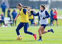 COMMERCE CITY, CO - OCTOBER 24: Ashley Hatch of the USWNT dribbles past Ashley Sanchez during a training session at Dick's Sporting Goods Park training fields on October 24, 2020 in Commerce City, Colorado.