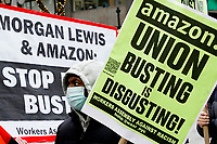 NEW YORK, NEW YORK - MARCH 04: A man holds a placard during a protest to support Amazon workers in Alabama on March 04, 2021 in New York. Amazon is the second largest employer in the United States - with 400,000 workers and about 1.3 million employees worldwide. (Photo by Emaz/VIEWpress)