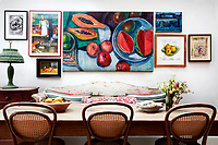 Several paintings by Lonika Chande's mother, artist Lucy Dickens, hang on the walls around the house, including this one of tropical fruit in the dining area of the kitchen