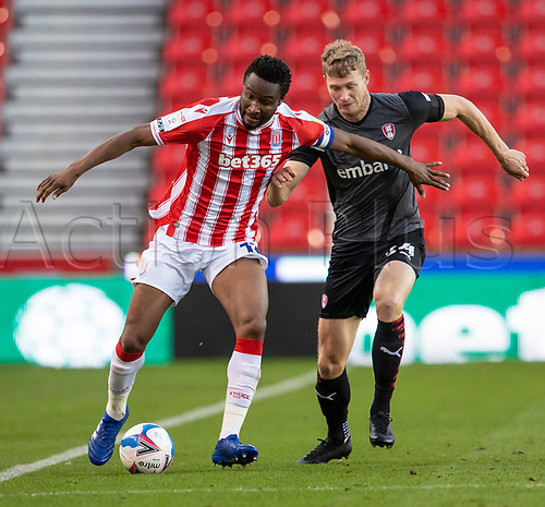 31st October 2020; Bet365 Stadium, Stoke, Staffordshire, England; English Football League Championship Football, Stoke City versus Rotherham United; John Obi Mikel of Stoke City is tackled by Jacob Gratton of Rotherham United