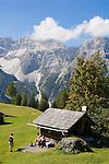 Italy, South Tyrol, Alto Adige, Dolomites, Moso: hiking region Prati di Croda Rossa with hut, hikers and Punta Tre Scarperi mountain