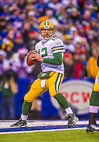 14 December 2014: Green Bay Packers quarterback Aaron Rodgers looks for an open receiver in the third quarter against the Buffalo Bills at Ralph Wilson Stadium in Orchard Park, NY. The Bills defeated the Packers 21-13, snapping the Packers' 5-game winning streak and keeping the Bills' 2014 playoff hopes alive. Mandatory Credit: Ed Wolfstein Photo *** RAW (NEF) Image File Available ***