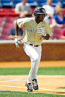 Kevin Jordan #21 of the Wake Forest Demon Deacons hustles down the first base line against the Florida State Seminoles at Wake Forest Baseball Park on March 25, 2012 in Winston-Salem, North Carolina.  The Demon Deacons defeated the Seminoles 7-5.  (Brian Westerholt/Four Seam Images)