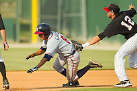 Eric Garcia (8) of the Rome Braves is tagged out by Michael Marjama (12) of the Kannapolis Intimidators after having been picked off of first base at CMC-Northeast Stadium on June 16, 2013 in Kannapolis, North Carolina.  The Intimidators defeated the Braves 6-4.   (Brian Westerholt/Four Seam Images)