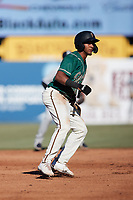 Lolo Sanchez (34) of the Greensboro Grasshoppers takes his lead off of second base against the Hudson Valley Renegades at First National Bank Field on September 2, 2021 in Greensboro, North Carolina. (Brian Westerholt/Four Seam Images)