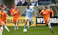 Chicago Red Stars midfielder Carli Lloyd (10) dribbles though the Sky Blue FC defense while Sky Blue FC defender Keeley Dowling (17, right) pursues.  The Chicago Red Stars tied Sky Blue FC 0-0 at Toyota Park in Bridgeview, IL on April 19, 2009.