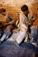 Polishing cannon of a hunting gun and of newly made Kalashnikovs. Darra town in Pakistan clandestinely provides arms to more than eight Central Asian countries.