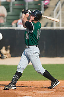 Augusta shortstop Anthony Contreras (14) follows through on his swing in game action versus the Kannapolis Intimidators at Fieldcrest Cannon Stadium in Kannapolis, NC, Sunday, June 18, 2006.
