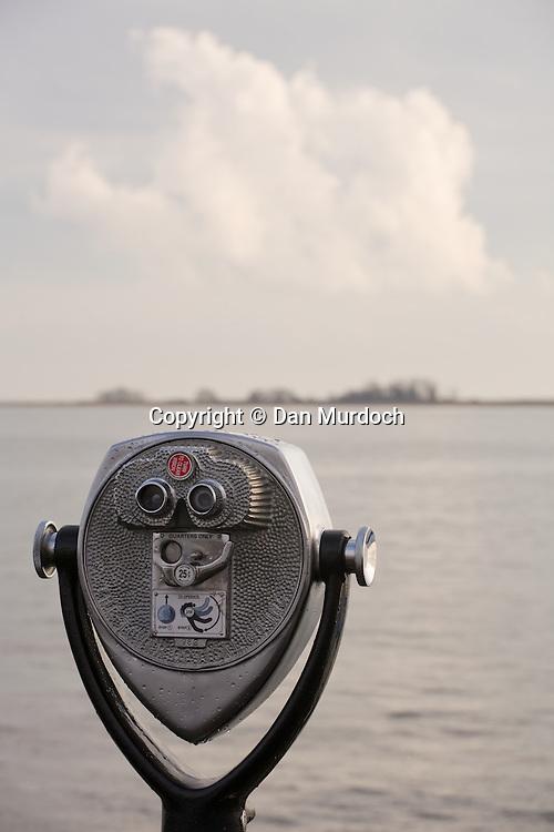Coin binoculars overlooking island