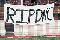 """A sign reads """"RIP DNC"""" on the fence on the outside of the secure area surrounding the Democratic National Convention at the Wells Fargo Center in Philadelphia, Pennsylvania, on Wed., July 27, 2016."""
