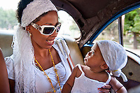 Mother with baby in back of taxi.
