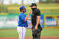 Dunedin Blue Jays manager Luis Hurtado (13) argues a call with umpire Casey James during a game against the Bradenton Marauders on May 13, 2021 at BayCare Ballpark in Clearwater, Florida.  (Mike Janes/Four Seam Images)