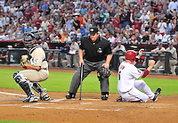 Apr. 18, 2008; Phoenix, AZ, USA; Home plate umpire Joe West looks on as Arizona Diamondbacks base runner Stephen Drew safely slides into home to score as San Diego Padres catcher Colt Morton waits for the throw in the first inning at Chase Field. Mandatory Credit: Mark J. Rebilas-