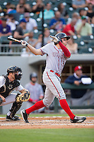 Matt den Dekker (3) of the Syracuse Chiefs follows through on his swing against the Charlotte Knights at BB&T BallPark on June 1, 2016 in Charlotte, North Carolina.  The Knights defeated the Chiefs 5-3.  (Brian Westerholt/Four Seam Images)