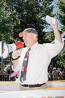 The attorney representing the Straight Pride Parade speaks to parade participants before the parade in Boston, Massachusetts, on Sat., August 31, 2019. The parade was organized in reaction to LGBTQ Pride month activities by an organization called Super Happy Fun America. During the speech, he held a copy of a lawsuit he said he was ready to file if the parade was not allowed to go on and he also said he was objecting to police attempts to keep media away from the parade marchers.