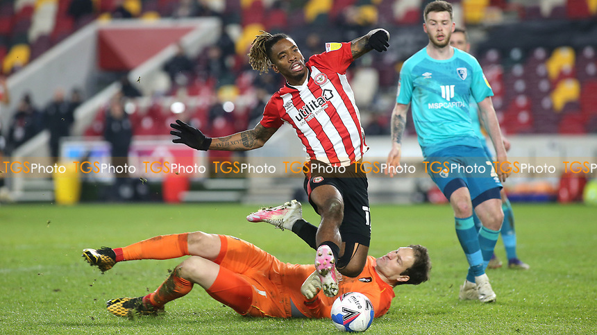 Ivan Toney of Brentford leaps over AFC Bournemouth goalkeeper, Asmir Begovic during Brentford vs AFC Bournemouth, Sky Bet EFL Championship Football at the Brentford Community Stadium on 30th December 2020