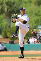 Charleston RiverDogs pitcher Andrew Benak #31 pitching during a game against the Greenville Drive at Joseph P. Riley Jr. Ballpark  on April 9, 2014 in Charleston, South Carolina. Greenville defeated Charleston 6-3. (Robert Gurganus/Four Seam Images)