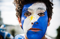 Argentine fan painted in the colors of his flag, before the game where Argentina had a dramatic victory over Iran 1-0, in a match played in Belo Horizonte, with last-minute goal from Lionel Messi, considered the best player in the world years. Rio de Janeiro, Brazil.