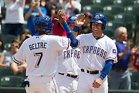 Round Rock Express third baseman Mike Olt #20 greets teammate Engel Beltre #7 as he scores against the New Orleans Zephyrs in the Pacific Coast League baseball game on April 21, 2013 at the Dell Diamond in Round Rock, Texas. Round Rock defeated New Orleans 7-1. (Andrew Woolley/Four Seam Images).