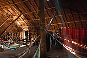 Xingu Indigenous Park, Mato Grosso, Brazil. Aldeia Matipu. Guest and family hammocks in traditional Oca house.