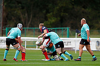Mark Bright of London Scottish laying off the ball during the Championship Cup match between London Scottish Football Club and Nottingham Rugby at Richmond Athletic Ground, Richmond, United Kingdom on 28 September 2019. Photo by Carlton Myrie / PRiME Media Images