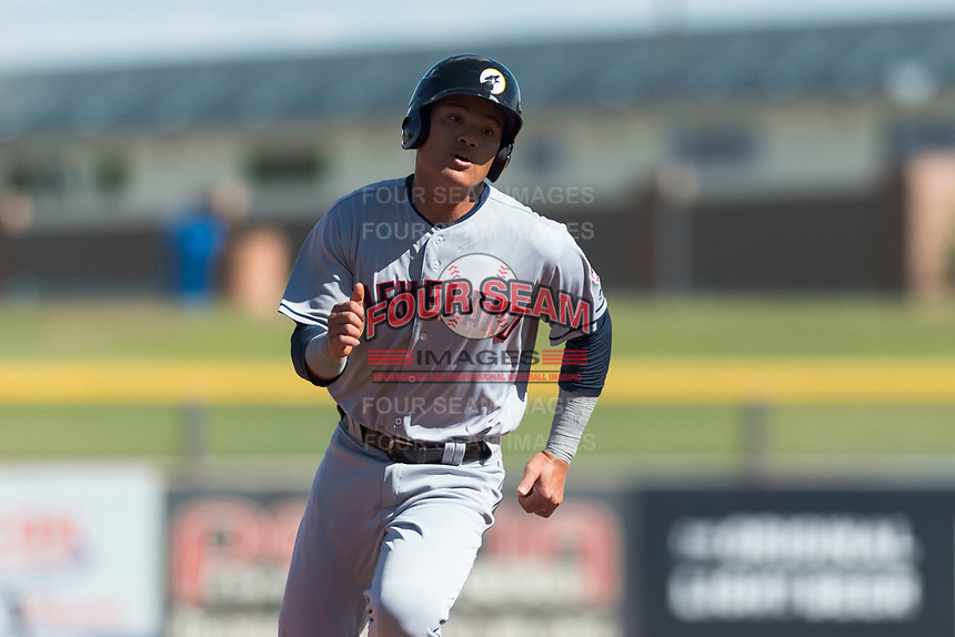 Glendale Desert Dogs third baseman Yu Chang (9), of the Cleveland Indians organization, rounds third base during an Arizona Fall League game against the Peoria Javelinas at Peoria Sports Complex on October 22, 2018 in Peoria, Arizona. Glendale defeated Peoria 6-2. (Zachary Lucy/Four Seam Images)