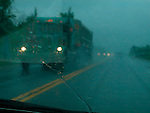 Vehicle driving through rain storm on highway