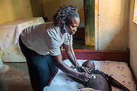 AWright_UG_002280.jpg <br /> Uganda<br /> Birungi Hajira, trained by BRAC as a nurse, performs a general check-up on a boy at the Iganga Medical Clinic. She took out a loan with BRAC to open the clinic and receive additional healthcare training. In the Iganga district, the biggest health issues are malaria, diarrheal disease and syphilis.