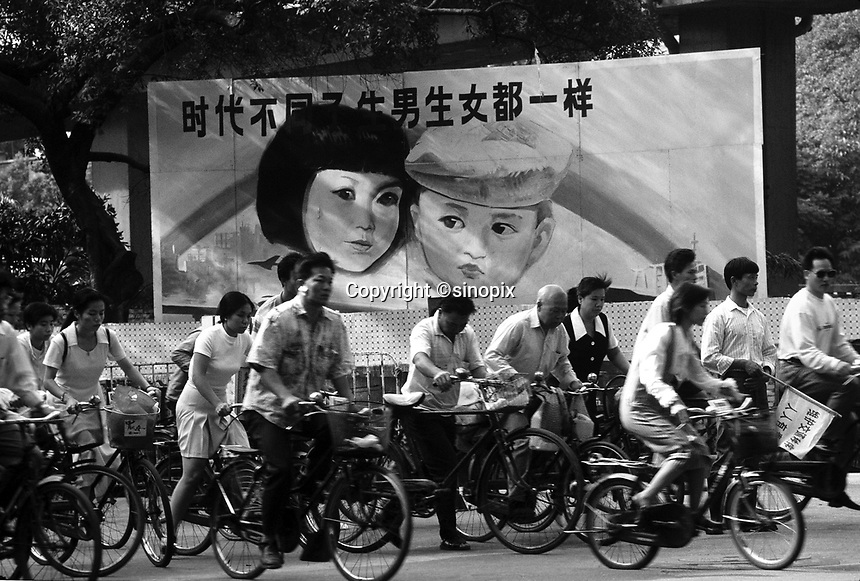 """A propoganda poster talks of sexual equality between boys and girls, """"In different times, having the boys and girls are the same"""". China's one-child policy has created  social disorder and an imbalance in the national birth rate, especially in the countryside where boys outnumber girls by as many as 150:100 born,  Guangzhou, China.<br /> 21 Mar 2001<br /> <br /> photo by Richard Jones / Sinopix"""