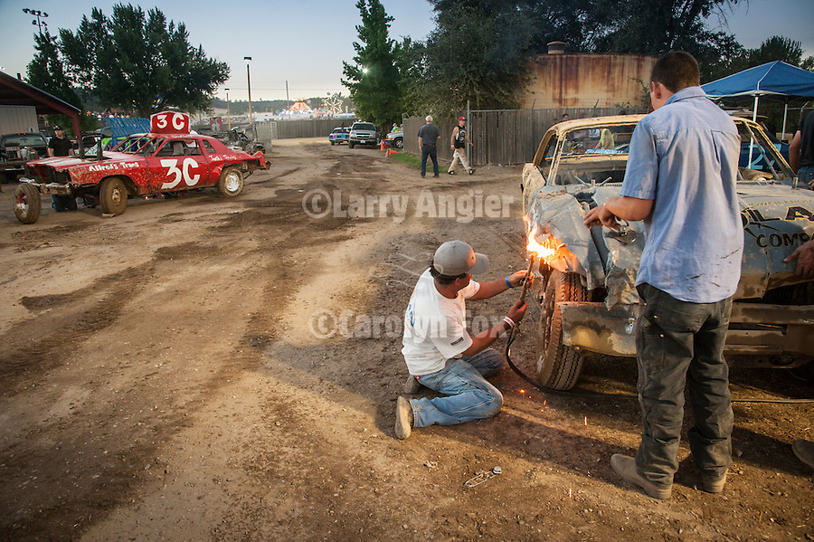 74th Amador County Fair, Plymouth, Calif...Behind the scenes repairs and fixes during a break at the Destruction Derby